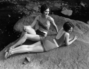 Two women relaxing on rock